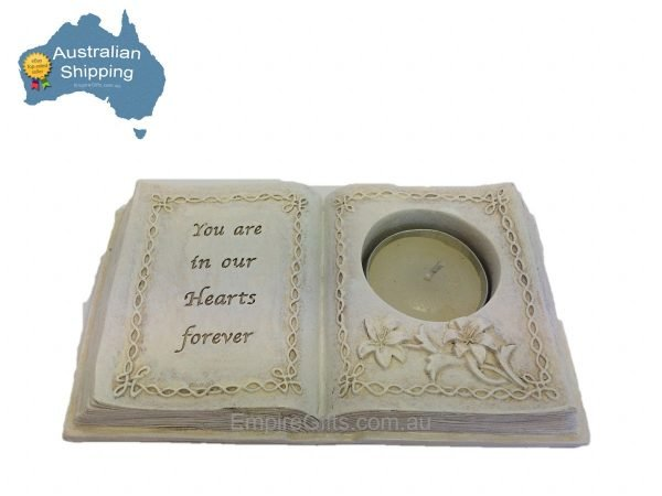 """Remember a loved one by lighting the candle the flicker flame will send your thoughts to heaven. Cream coloured stone look book include tealight candle. Message reads """"You are in our Hearts forever"""" Dimensions: W: 16cm H:3cm D: 9cm"""