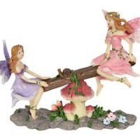 These adorable fairies are playing on a seesaw adorned with flowers, mushrooms and a cute sitting snail. Dimensions: This listing is for one fairies playing on seesaw