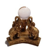 3 elephants statue with crystal ball